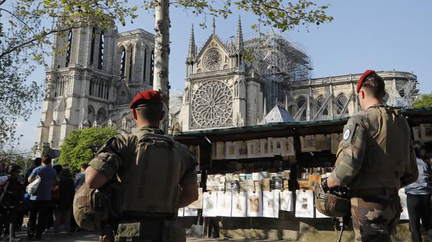 French soldiers on patrol along the side of Notre Dame Cathedral in Paris (Michel Euler/AP)