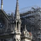 Firefighters walk on a balcony of Notre Dame cathedral (Francois Mori/AP/PA)