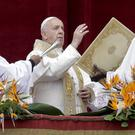 "Pope Francis delivers his Urbi Et Orbi (""to the city and the world"") blessing on Easter Sunday (Andrew Medichini/AP)"