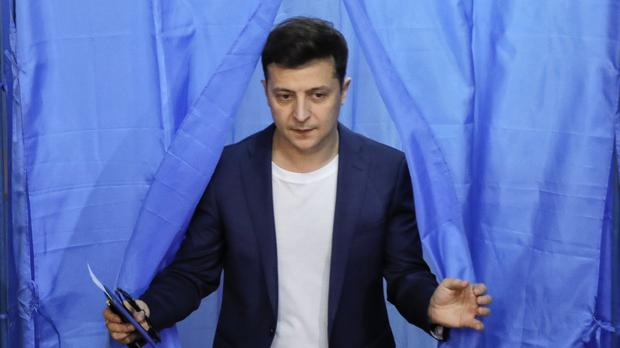 Ukrainian comedian and presidential candidate Volodymyr Zelenskiy leaves a booth at a polling station (Vadim Ghirda/AP)