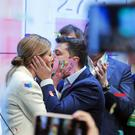 Ukrainian comedian and presidential candidate Volodymyr Zelenskiy and his wife Olena Zelenska kiss each other (Vadim Ghirda/AP)