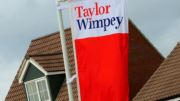 Shares in Taylor Wimpey are down (PA)