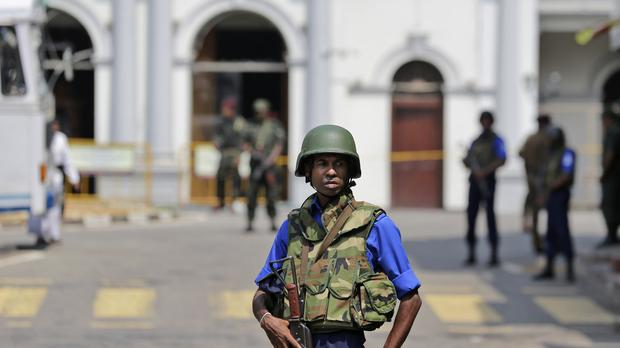 Sri Lankan navy soldiers secure the area out side St Anthony's Church in Colombo, Sri Lanka (Eranga Jayawardena/AP)