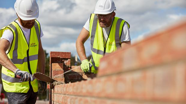Taylor Wimpey warned that it was costing more to build homes (Taylor Wimpey/PA)
