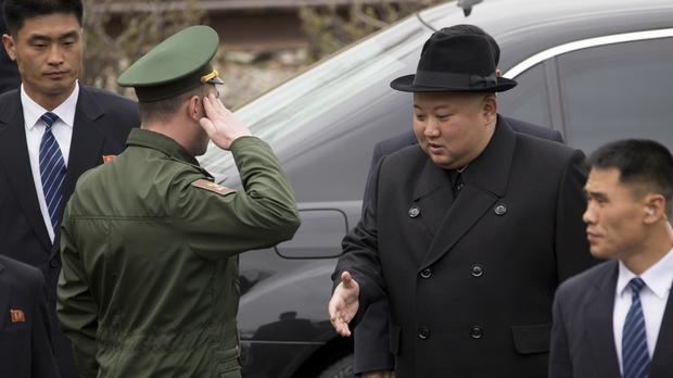 North Korean leader Kim Jong Un arrives for a wreath laying ceremony in Vladivostok, Russia (Alexander Khitrov/AP)