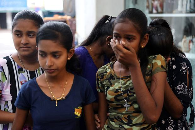 Shock: Girls react after seeing the damage to St Anthony's Shrine, in Colombo, after the bomb attacks. Photo: REUTERS/Athit Perawongmetha