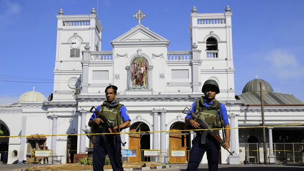 Sri Lankan Navy soldiers stand guard in front of the St Anthony's Shrine (Eranga Jayawardena/AP)
