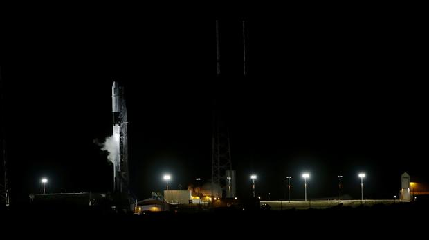 A SpaceX Falcon 9 sits on space launch complex 40 after the launch was held up (AP)