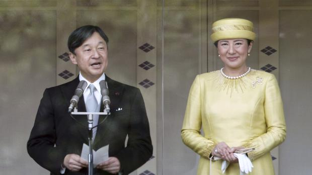 Naruhito was accompanied by Empress Masako at the Imperial Palace in Tokyo (AP)