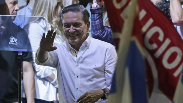 Presidential candidate Laurentino Cortizo, of the Democratic Revolutionary Party, waves to supporters in Panama City (Arnulfo Franco/AP)