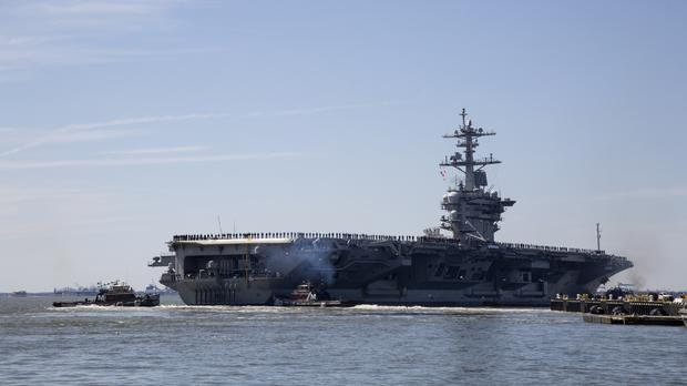 The US is deploying the USS Abraham Lincoln Carrier Strike Group and a bomber task force to an area that includes the Middle East (Kaitlin McKeown/The Virginian-Pilot via AP, File)