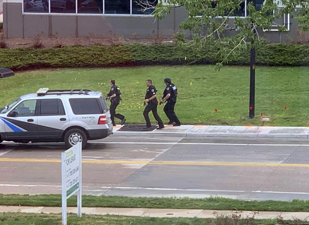 Armed police officers at the school (Courtney Harper via AP)