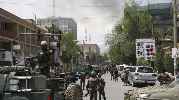 Afghan security personnel near the site of an explosion in Kabul (Rahmat Gul/AP)