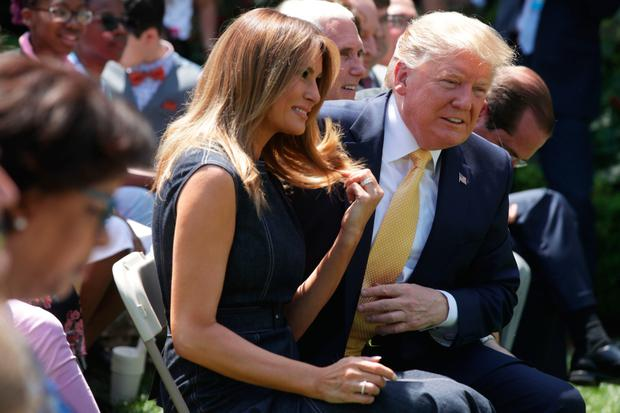 Denial: President Donald Trump and First Lady Melania Trump at a Rose Garden event at the White House. Photo: Getty Images