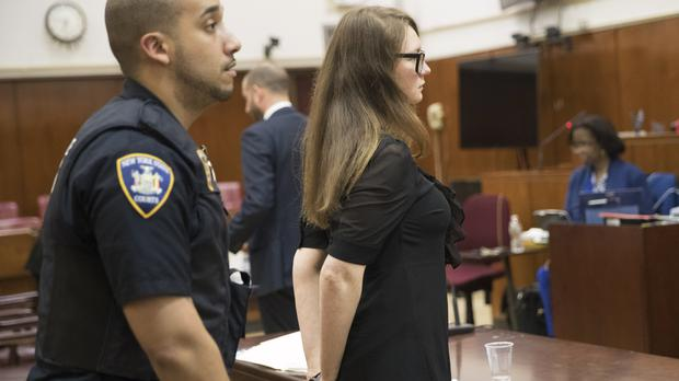 Court officers escort Anna Sorokin from the courtroom (Mary Altaffer/AP)