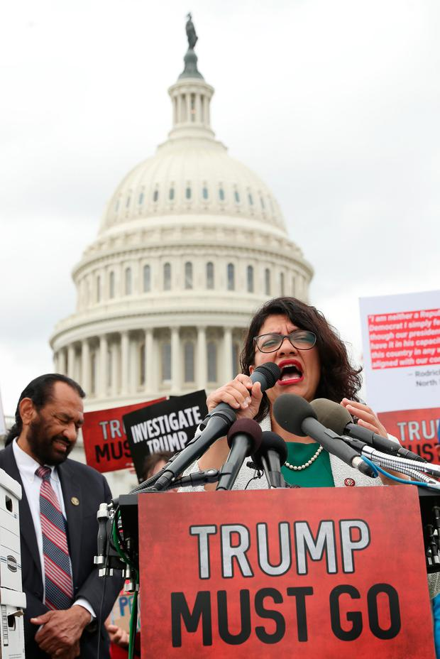 Protest: Rashida Tlaib (D-MI) urging the Congress to impeach Mr Trump. Photo: Mark Wilson/Getty Images