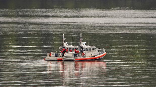 Two US Coast Guard search at the site of a collision between two float planes (Dustin Safranek/Ketchikan Daily News via AP)