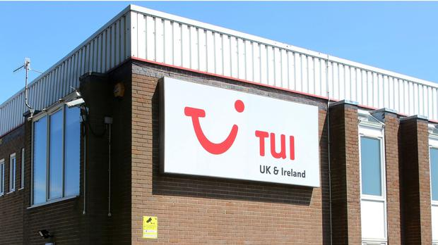 Holiday giant Tui has suffered widened losses for the half-year (PA)