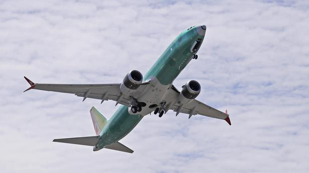 A Boeing 737 MAX 8 jetliner takes off on a test flight (Ted S. Warren/AP)