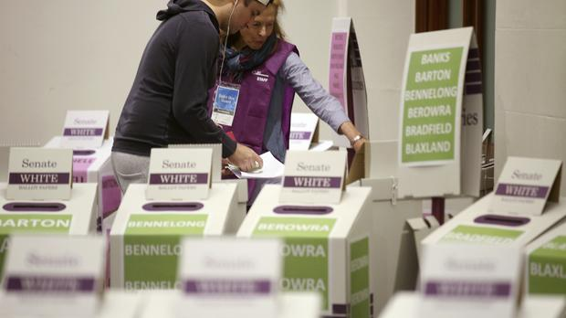 A voter casts their ballot at Town Hall in Sydney (AP Photo/Rick Rycroft)