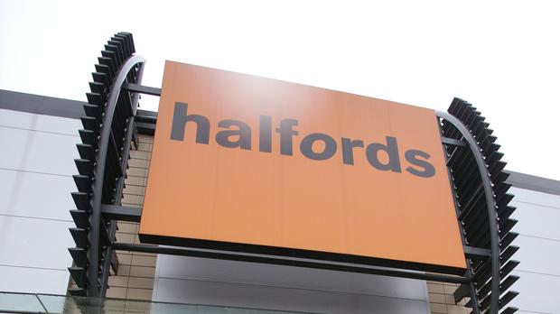 Halfords has reported a dip in profits (PA)