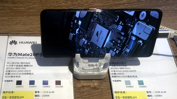 Smartphone and tablet manufacturers often use US, Japanese or Taiwanese microchips (AP Photo/Andy Wong)