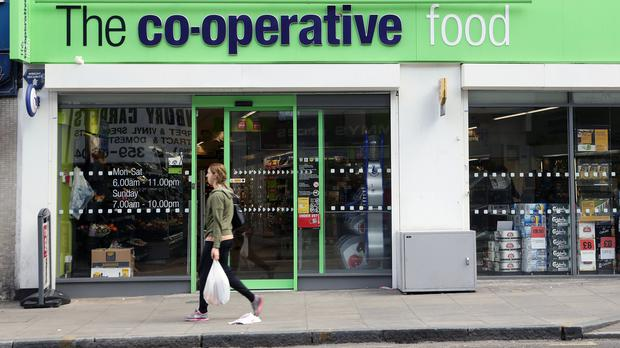 Customers will be able to pick up John Lewis orders from a select number of Co-op shops as part of the trial (PA)