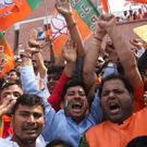 Bharatiya Janata Party (BJP) supporters celebrate their party's victory in the general elections in New Delhi, India (Manish Swarup/AP)