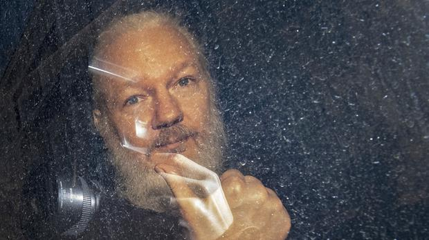 New charges have been filed in the US against Julian Assange (Victoria Jones/PA)