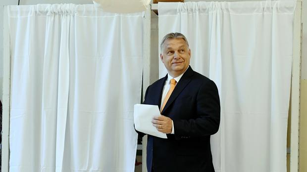 Hungarian Prime Minister Viktor Orban smiles before casting his vote at a polling station in Budapest(Szilard Koszticsak/MTI/AP