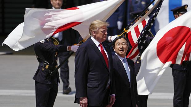 Donald Trump is escorted by Japan's Emperor Naruhito during a welcoming ceremony at the Imperial Palace (Franck Robichon/Pool Photo via AP)