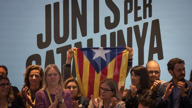 Supporters of JxCat party celebrate the results of the elections at their headquarter in Barcelona, Catalonia, Spain (Emilio Morenatti/AP)