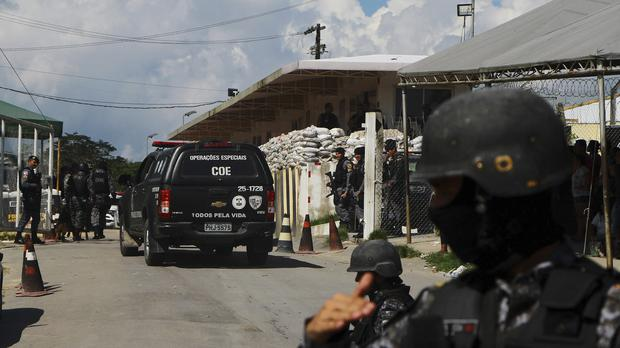 Police guard the entrance to the Anisio Jobim Prison Complex after a deadly riot erupted among inmates (AP/Edmar Barros)
