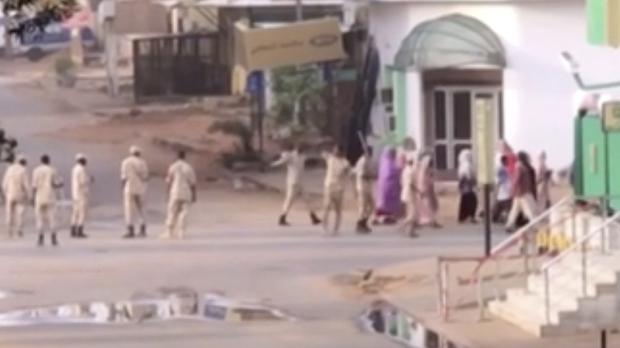 Sudanese forces escort civilians in Khartoum (AP)