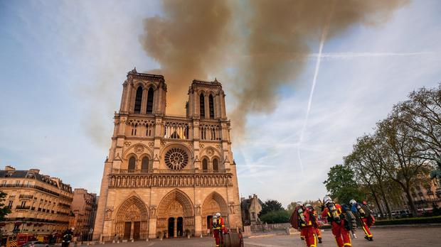 Firefighters at the scene of the cathedral fire in April (Benoit Moser / Pompiers de Paris/PA)