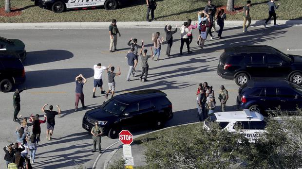 Students as they were evacuated by police from Marjory Stoneman Douglas High School in Parkland (Mike Stocker/South Florida Sun-Sentinel/AP)