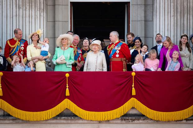 Britain's Queen Elizabeth II is joined by members of the royal family, including the Wiilaim and Kate (Duke and Duchess of Cambridge) with their children Prince Louis, Prince George and Princess Charlotte; Camilla (Duchess of Cornwall) and Charles (Prince of Wales); Anne (Princess Royal); Andrew (Duke of York); Meghan and Harry (Duke and Duchess of Sussex); and Peter and Autumn Phillips and their children Savannah and Isla, on the balcony of Buckingham Place to watch the flypast after the Trooping the Colour ceremony, as she celebrates her official birthday. All photos: Victoria Jones