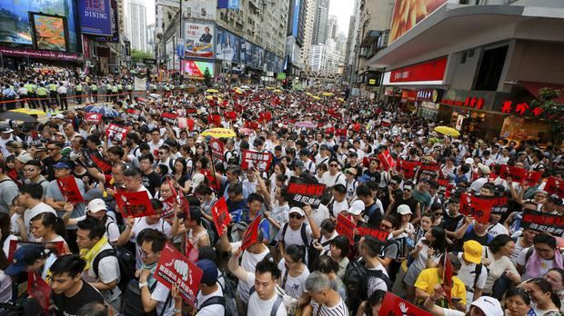 Protesters take to the streets of Hong Kong (Kin Cheung/AP)