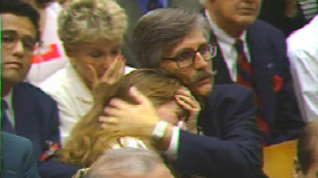 Ron Goldman's sister Kim buries her face in her hands and weeps as her father Fred, centre, holds her in disbelief as the jury returns the not-guilty verdict (AP)