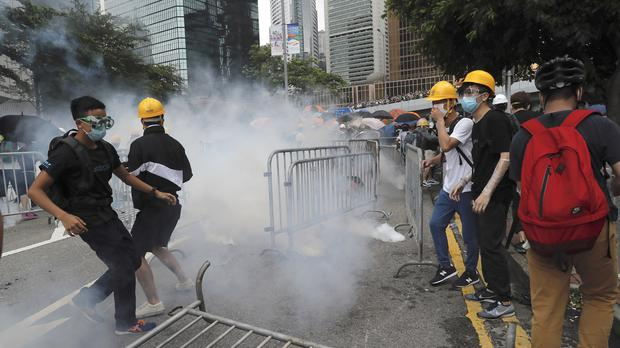 Tear gas rains down on protesters in Hong Kong (Kin Cheung/AP)