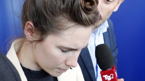 Amanda Knox is approached by a journalist upon her arrival in Linate airport, Milan (Antonio Calanni/AP)