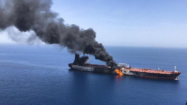 An oil tanker is on fire in the sea of Oman, Thursday, June 13, 2019 (AP)