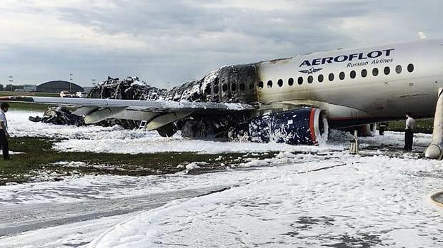 A Russian Sukhoi Superjet 100 aircraft which crashed in May, killing 41 people, lost autopilot after a lightning strike and came in to land at excessive speed, according to crash investigators, Russian news agencies have reported. (Moscow News Agency/AP)