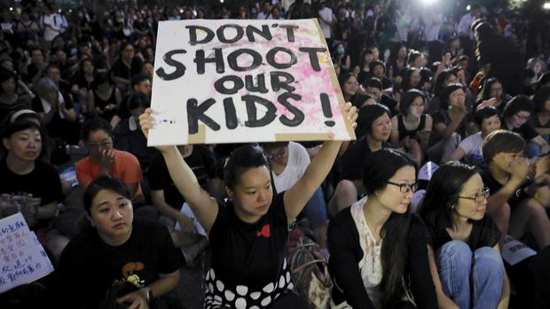 Hundreds of mothers protest against the amendments to the extradition law in Hong Kong (AP)