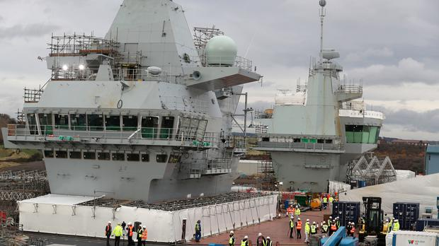 Babcock and Serco both hold contracts with the Ministry of Defence (Andrew Milligan/PA)