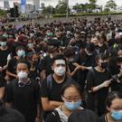 Protesters wearing masks gather near the Legislative Council in Hong Kong (Kin Cheung/AP)