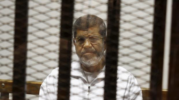 Egypt's ousted president Mohammed Morsi, who collapsed during a court session and died (Tarek el-Gabbas/AP)