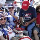 Supporters of President Donald Trump wait in line hours before the arena doors open for a campaign rally in Orlando, Florida (John Raoux/AP)