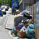 Piles of rubbish in the streets of Mostar, Bosnia (Denis Leko/FENA via AP)