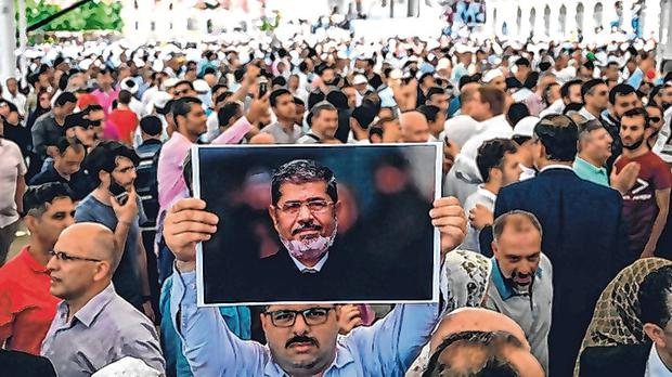 A man holds a picture of Mohamed Morsi during a symbolic funeral in Istanbul. Photo: AFP/Getty Images